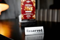 Reserved the table. Close-up photo of `Reserved` the table on the blur background Stock Images