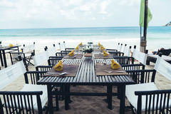 Reserved  table at the sea shore on tropical beach. Reserved table at the sea shore on tropical resort beach Royalty Free Stock Image