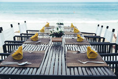 Reserved  table at the sea shore on tropical beach. Reserved table at the sea shore on tropical resort beach Stock Image