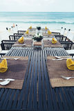 Reserved  table at the sea shore on tropical beach. Reserved table at the sea shore on tropical resort beach Royalty Free Stock Photos