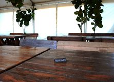 Reserved Table Sign. Garden Restaurant With Reserved Table Sign And Wooden Furnitures stock photography