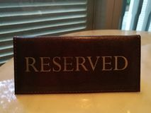 Reserved table sign in restaurant for secure your dating and special moment with friend, family, lover, couple, mate. Husband, wife boyfriend and girlfriend Stock Photo