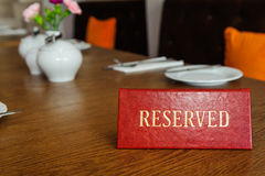 Reserved table. Reserved sign on a restaurant wooden table Royalty Free Stock Photography