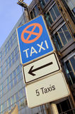 Reserved for taxi. Taxi sign in front of a large business building Royalty Free Stock Photos