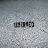 A reserved text parking sign stock photo