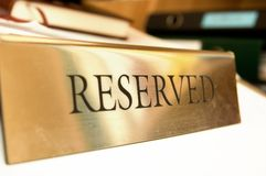 Reserved title. Picture of a fancy metal reserved title Stock Photo