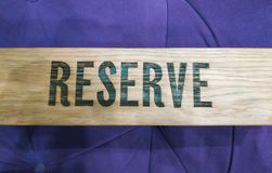 Reserved Wooden table in restaurant at blue interior stock photography