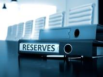 Reserves on Binder. Blurred Image. 3D. Reserves - Office Folder on Wooden Desktop. Reserves. Business Concept on Blurred Background. Reserves - Business Concept Stock Photo