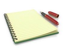 Reservoarpenna med anteckningsboken Arkivfoto