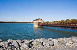 Reservoir. A reservoir with a pier and a building over the water Royalty Free Stock Images