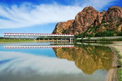 Reservoir. With red mountain nearby Stock Image
