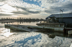 Reservoir, boat house and cloud reflections Stock Images