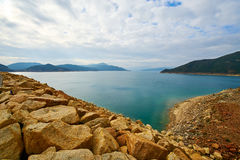 The reservoir and clounscape. The photo was taken in High Island reservoir Sai kung East Country park Hongkong, China Royalty Free Stock Photo