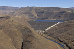 Reservoir Earth Wall in Mountains. Winter colours on the Mohale Dam in Lesotho Royalty Free Stock Images