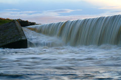 Reservoir flooding. An overfull reservoir flooding at twighlight Royalty Free Stock Image