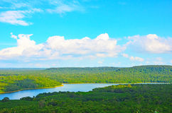 Reservoir with forest. Under blue sky Royalty Free Stock Photography
