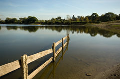 Reservoir landscape view. Welford reservoir empty enough to reveal a usually hidden fence royalty free stock photography