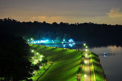 Reservoir with lighted meadows by night Royalty Free Stock Photo
