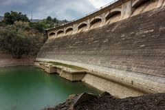 Retaining wall of the lemon reservoir in Malaga. Reservoir located north of the municipal district of Málaga. It was built in 1983 occupying a total area of Stock Image