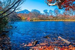 Reservoir Near The Mountain Filled With Leaves Change Color. In The Fall Leaves With Blue Skies And White Clouds In Akita Japan Stock Photos