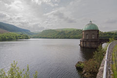 Reservoir and Ornate Building. An ornate building, within a picturesque lake and reservoir Stock Photography