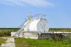 Reservoir for sludge of oil emulsion. Equipment at the oil field. Reservoir for sludge of oil emulsion. Equipment at the oil field stock photography