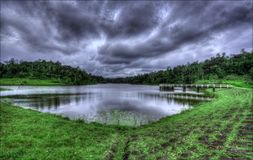 A Reservoir Tank Lake with Green Grass lakeshore stock photo