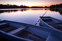 Reservoir at twilight with two boats in the foreground - Saxony, Germany. Royalty Free Stock Images