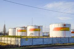Reservoirs with fuel at the oil depot of Rosneft. Tanks in the light of the setting sun. stock image