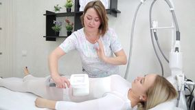 Reset body weight with LPG massage. The blonde girl, in order to care for her figure, attends an LPG massage session in a beauty salon stock video