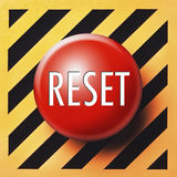 Reset button. Red button with reset in white letters on diagonal orange and black background
