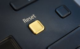 Reset button. Yellow Reset button on a copy machine Royalty Free Stock Image