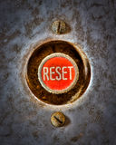 Reset the Grunge. Grunge image of a red reset button from an old piece of machinary Stock Photo