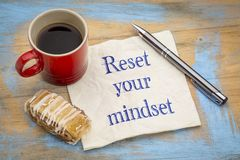Reset your minset advice on a napkin royalty free stock images