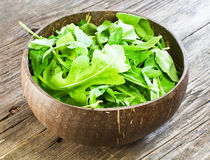 Resh arugula salad. On wooden table stock images