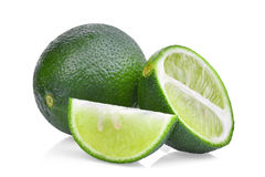 Resh green lime with half and slice isolated on white Royalty Free Stock Images