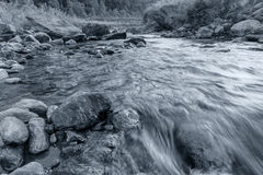 Reshi River water flowing on rocks at dawn, Sikkim, India Stock Photo