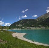 Resia Lake. View to Resia from the lake, Resia, Italy Stock Photography