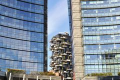 Residence `Bosco Verticale` in the gap between two skyscrapers of the business Unicredit centre of Milan. stock photo