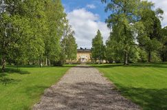 The residence in early summer greenery. County Governor's Residence Luleå construction began 1852nd Royalty Free Stock Photo