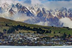 Residence and rural farm against high mountain in queenstown southland new zealand royalty free stock photo