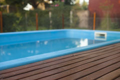 Residence with swimming pool and deck Royalty Free Stock Photo