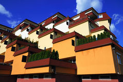 Residences. Colourful orange and yellow residences with terraces stock photos