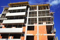 Residences construction. Unfinished residential building construction - brick and concrete walls royalty free stock image