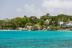 Residences off the coast of Barbados. Residences as seen from a catamaran off the coastline of Barbados Stock Image