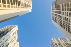 Resident apartment buildings against blue sky. Real estate background.  Stock Images