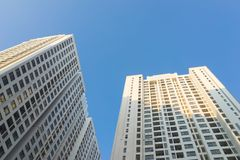Resident apartment buildings against blue sky. Real estate background.  Stock Image