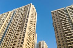 Resident apartment buildings against blue sky. Real estate background.  Royalty Free Stock Image