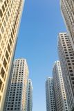 Resident apartment buildings against blue sky. Real estate background.  Royalty Free Stock Photography