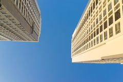 Resident apartment buildings against blue sky. Real estate background.  Royalty Free Stock Photo